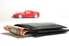 wallet with money and car toy