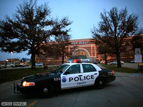 A police car sits outside the Westroads Mall in Omaha, Nebraska