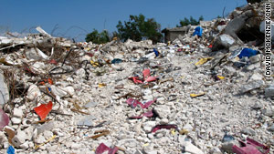 Debris litters the rubble of GOC University, a college known for its civil engineering and economics programs.