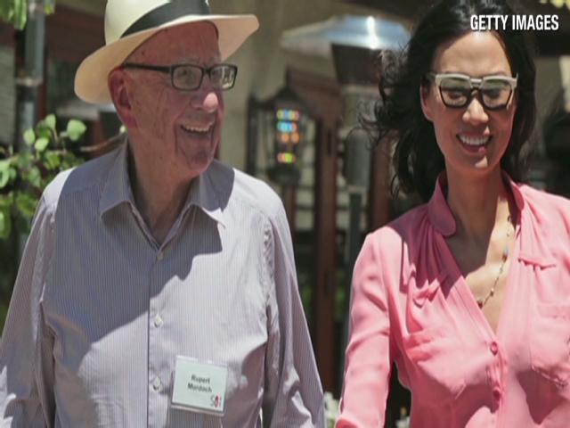 Wendi Deng Murdoch and husband