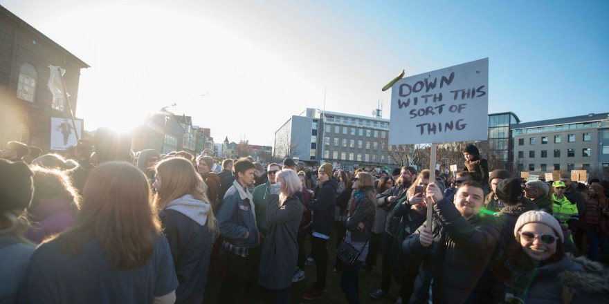 """People protest against Icelands Prime Minister Sigmundur David Gunnlaugsson outside parliament in Reykjavik, Iceland on April 4, 2016. Iceland's prime minister faced calls to resign after leaked """"Panama Papers"""" tax documents showed he and his wife used an offshore firm to allegedly hide million-dollar investments. / AFP / HALLDOR KOLBEINS (Photo credit should read HALLDOR KOLBEINS/AFP/Getty Images)"""