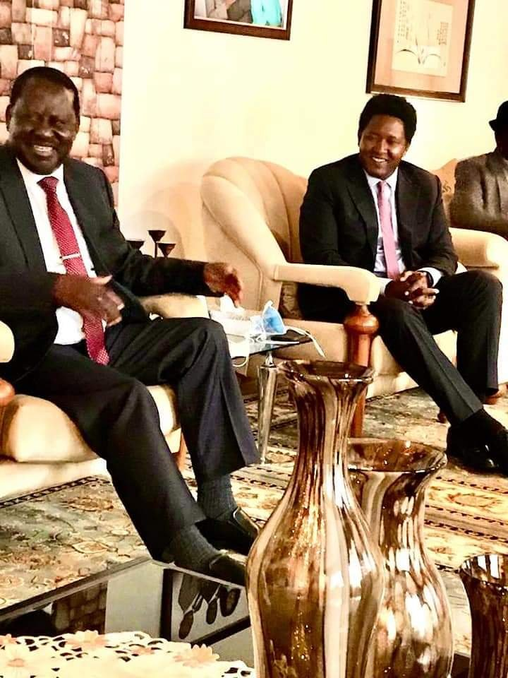 CAPTION: ODM Party Leader Raila Odinga with Narok Senator Ledama Ole Kina and a section of Maasai leaders at his Karen home this morning where his forgiveness was delivered