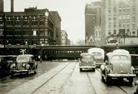sepia photo of cars, train