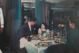 family dining on train