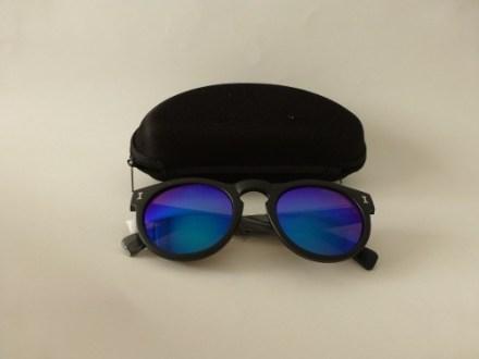 http://articulo.mercadolibre.com.ar/MLA-617313788-lentes-de-sol-erika-marco-negro-opaco-espejados-y-negros-_JM