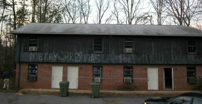 House Hacking - before pic - outside of fourplex - merry christmas spraypainted