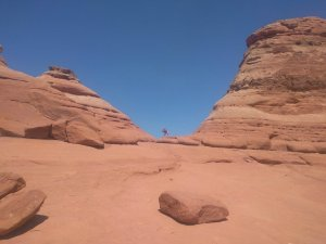 Financial Independence Using Real Estate Crowdfunding Loans - Kiddo Doing Yoga Pose at Arches National Park