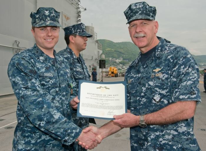 receiving award Navy - From Enlisted in the Navy to 35 Rentals in Only 11 Years