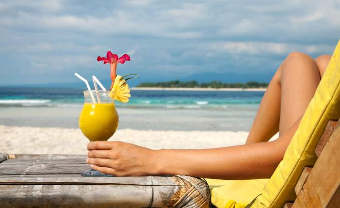 Pina colada on beach - What Suze Orman Got Wrong About the FIRE Movement