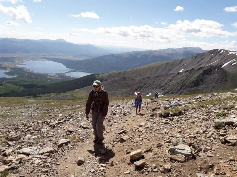 Chris Mamula and family hiking together