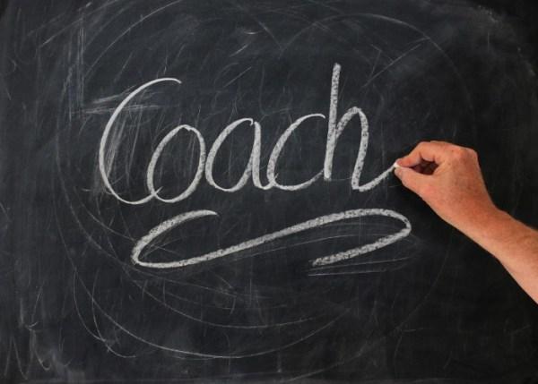 Afbeelding met tekst coach erop coach in Den Haag