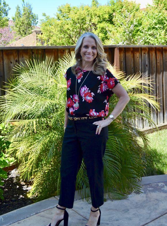 Floral top, Black pants, leopard belt