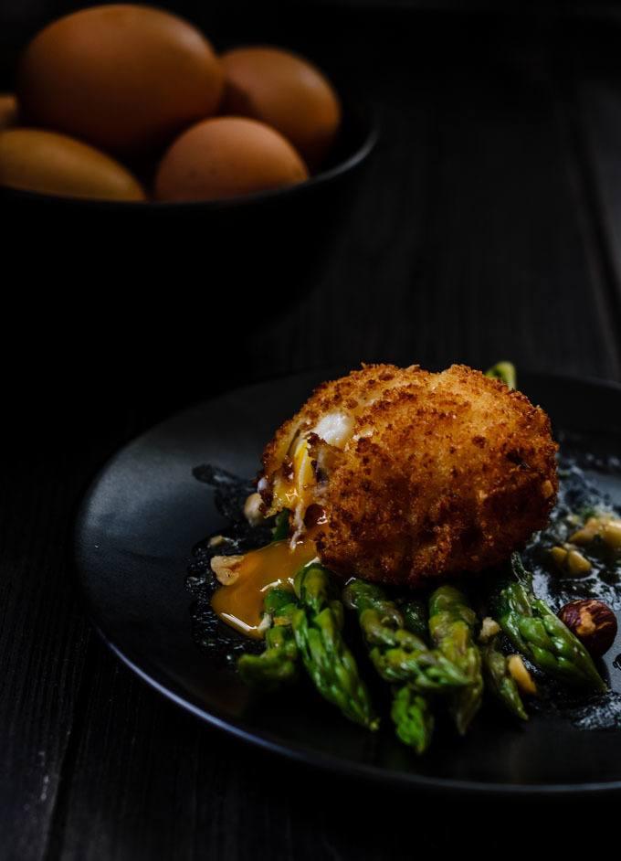 asparagus with crispy hazelnut duck eggs