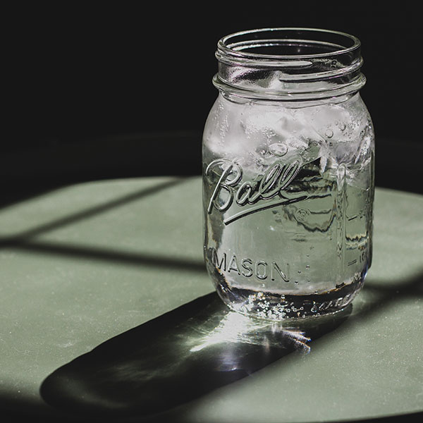 Mason jar full of water and ice cubes