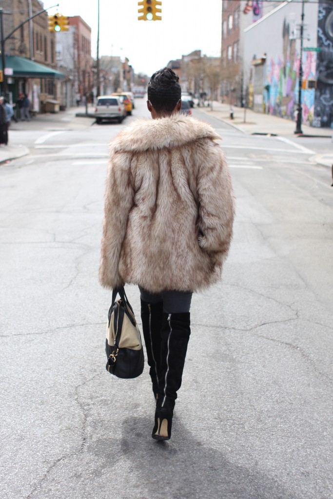 faux fur coat white top grey jeans black OTK boots mirrored sunglasses winter 2016 finale back view