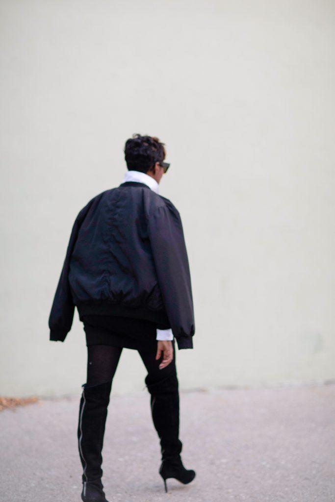 black bomber jacket white blouse black karl boyfriend sweatshirt black otk boots nyc fashion 2016 rear view
