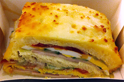 Coco&Me - www.cocoandme.com - Coco and Me - La Grande Épicerie de Paris - 'Le Croque Classic'. An indulgent looking sandwich made of bread, turkey, pancetta, cheddar, tomato, cucumber, hard boiled egg, iceberg salad, mayonnaise & worcestershire sauce. 5.90 euros. - Paris
