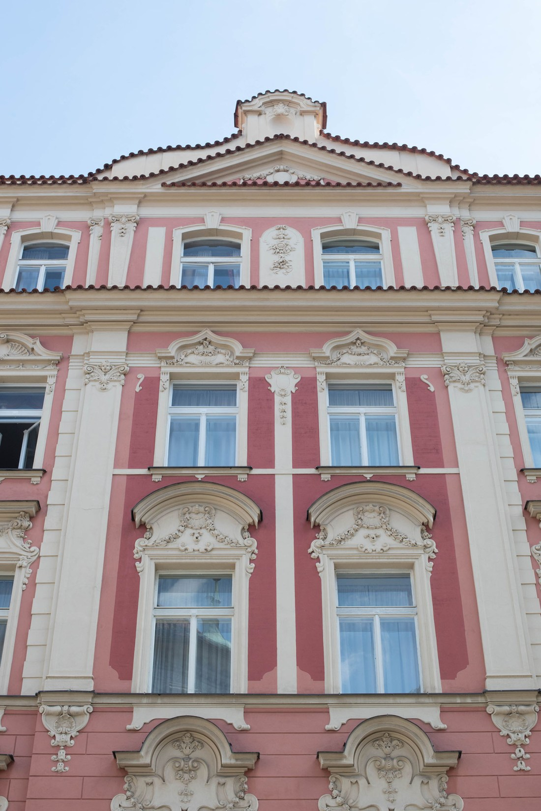 Pink and cream building in the old town of Prague, photographed by travel blogger Cee Fardoe of Coco & Vera