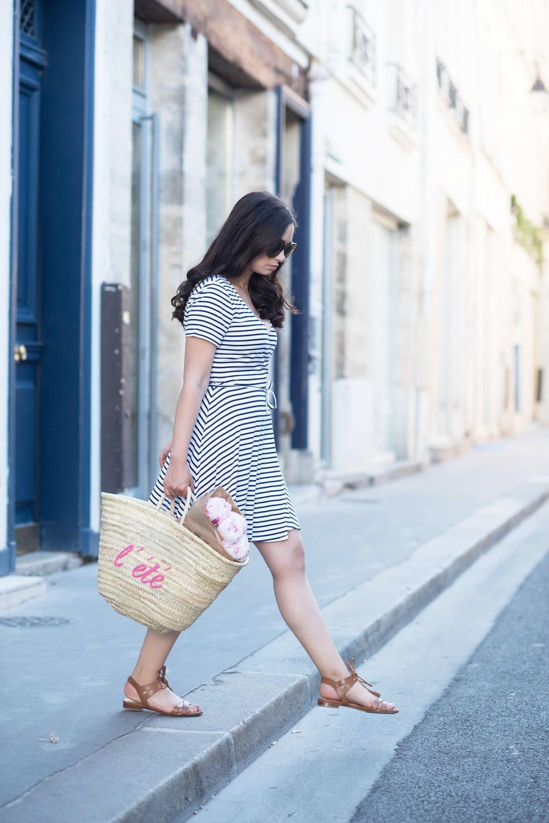 Fashion blogger Cee Fardoe of Coco & Vera walks through le Marais wearing a Lovers & Friends striped dress