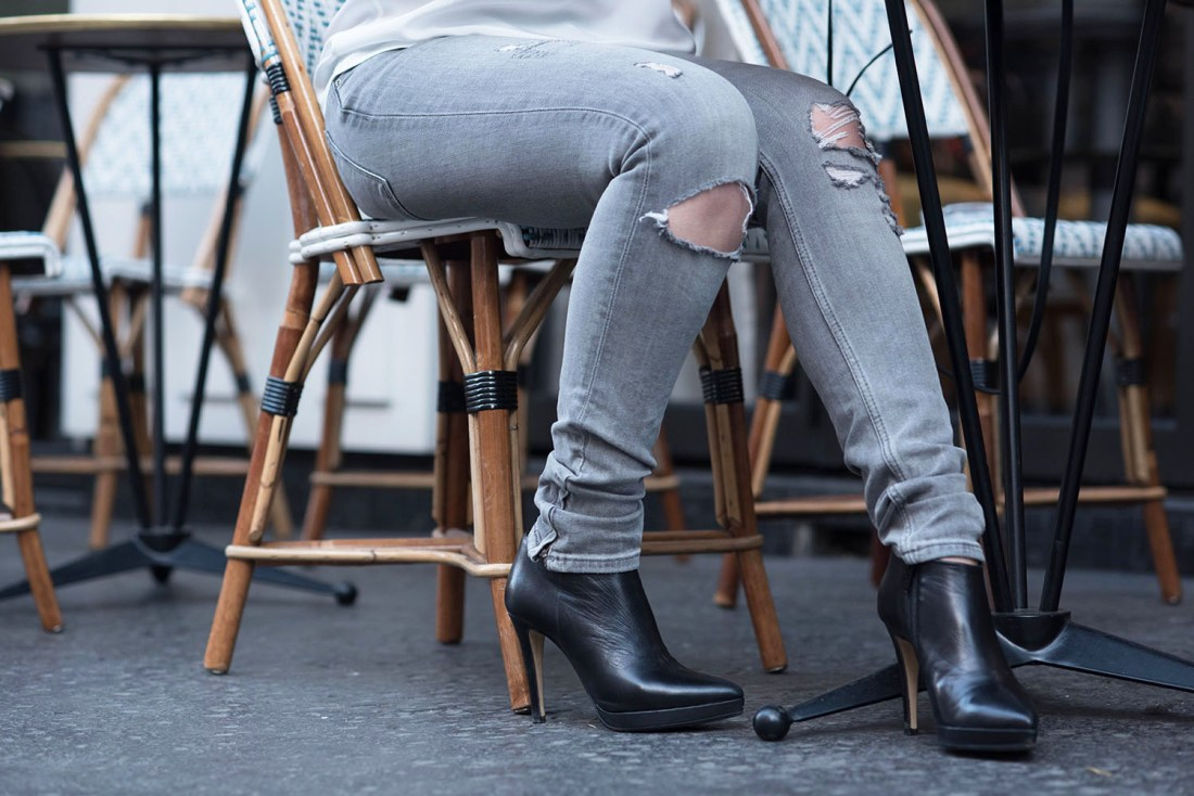 Outfit details on style blogger Cee Fardoe of Coco & Vera, including grey Zara jeans and Le Chateau leather ankle boots