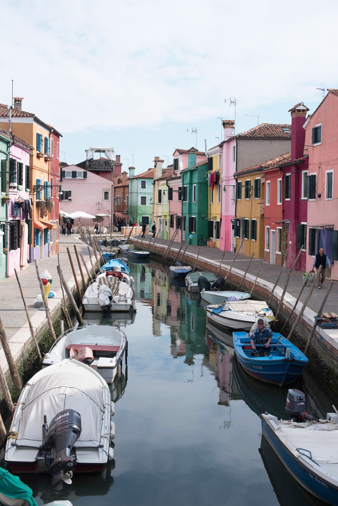 Colourful houses on either side of the canal in Burano, Italy, captured by travel blogger Cee Fardoe of Coco & vera
