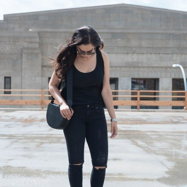 A simple all black everything outfit on fashion blogger Cee Fardoe of Coco & Vera, including Lovers + Friends jeans and a Charles & Keith bag