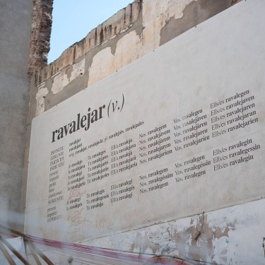 Street art in El Raval, Barcelona, featuring new verb Ravalejar, captured by travel blogger Cee Fardoe of Coco & Vera