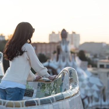 Portrait of fashion blogger Cee Fardoe of Coco & Vera looking out over Barcelona from Parc Guell