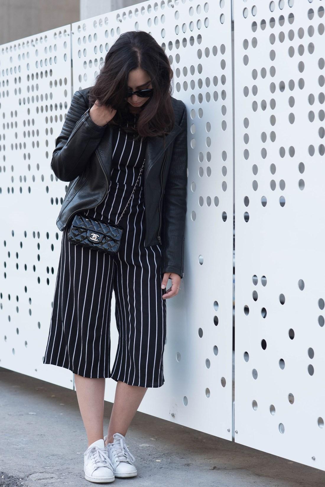 Winnipeg fashion blogger Cee Fardoe of Coco & Vera wears a black striped Missy Empire jumpsuit, white Adidas Stan Smith sneakers and Celine Audrey sunglasses