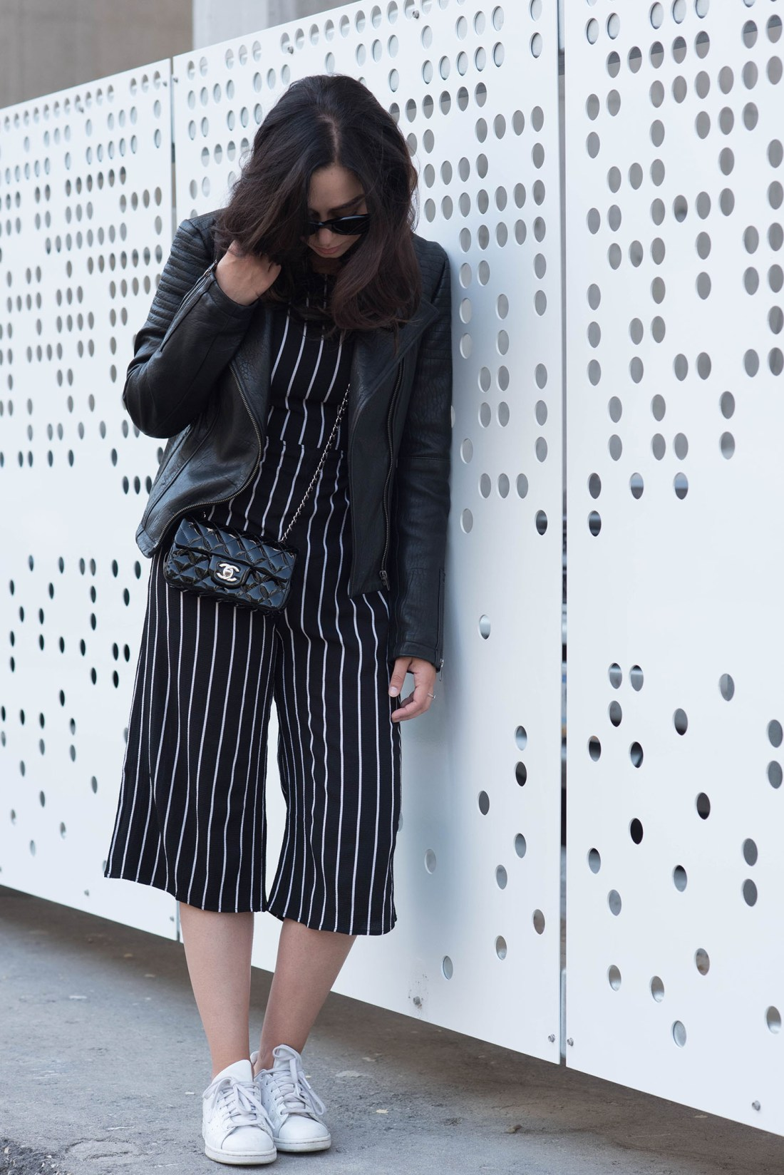 Winnipeg fashion blogger Cee Fardoe of Coco & Vera wears a black striped Missy Empire jumpsuit, white Adidas Stan Smith sneakers and Celine Audrey sunglasses
