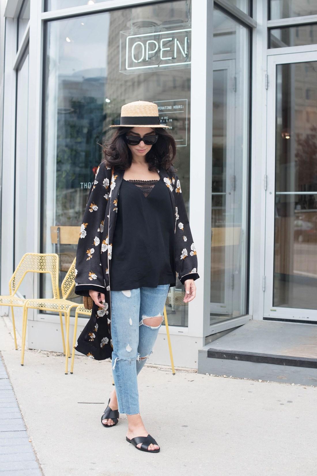 Winnipeg fashion blogger Cee Fardoe of Coco & Vera walks in front of Thom Bargen coffee shop wearing a Zara floral kimono and Grlfrnd Karolina jeans