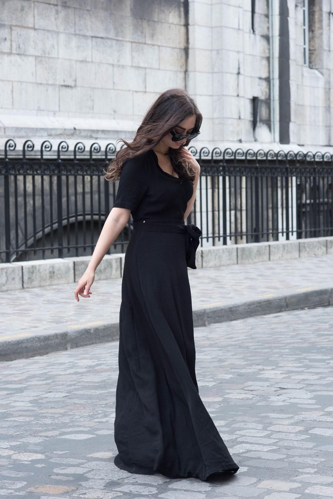Winnipeg fashion blogger Cee Fardoe of Coco & Vera walks in Montmartre wearing a black Ivy & Oak wrap dress
