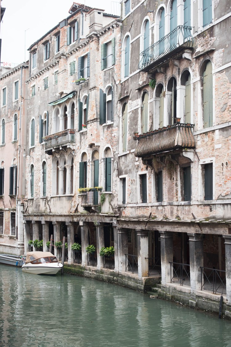 Typical white and green canal-side homes in Venice, Italy, as captured by travel blogger Cee Fardoe of Coco & Vera