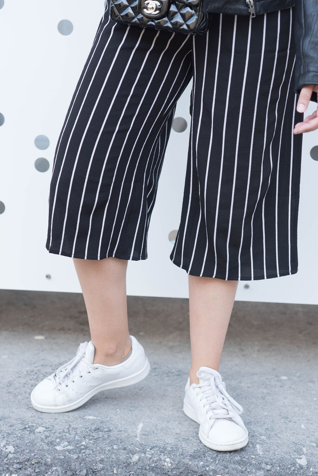 Outfit details on Winnipeg fashion blogger Cee Fardoe of Coco & Vera, wearing a Missy Empire striped jumpsuit, Adidas Stan Smith sneakers and black Chanel extra mini handbag