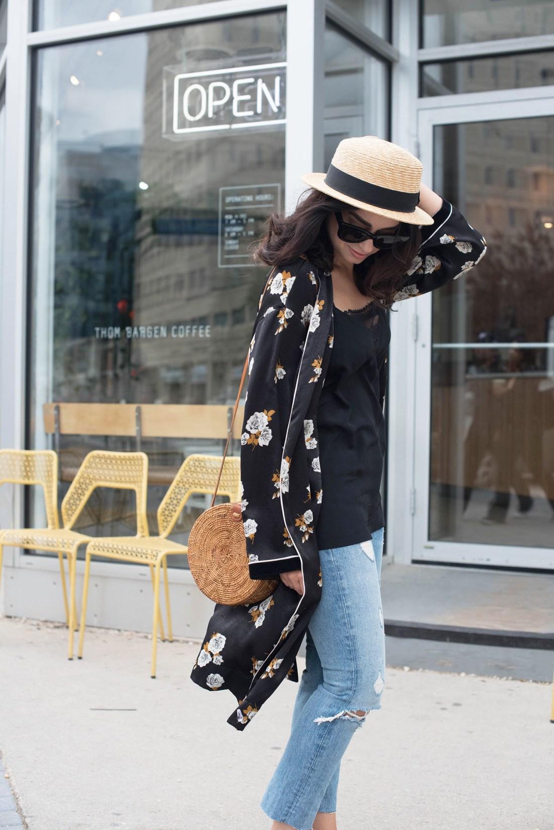 Fashion blogger Cee Fardoe of Coco & Vera holds onto her straw hat outside Thom Bargan coffee, wearing Grlfrnd Karolina jeans and a Zara black kimono
