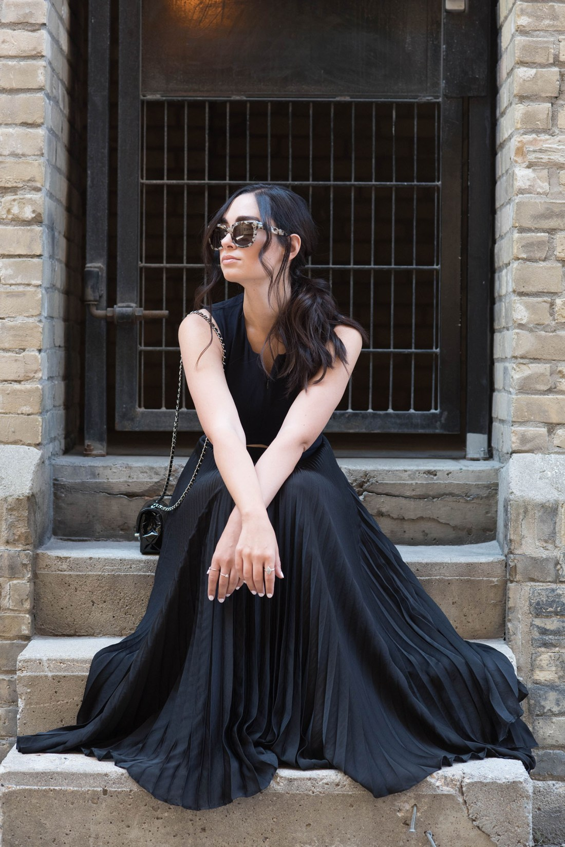 Winnipeg fashion blogger Cee Fardoe of Coco & Vera wears an ALC gown and a ponytail styled by Fran Rizzutto, while carrying a Chanel extra mini handbag