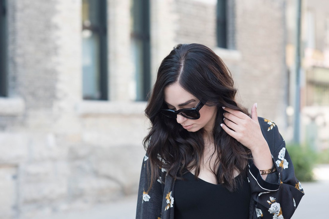 Portrait of Winnipeg fashion blogger Cee Fardoe of Coco & Vera wearing Celine Audrey sunglasses, a Zara combined kimono and flat iron waves styled by Fran Rizzutto