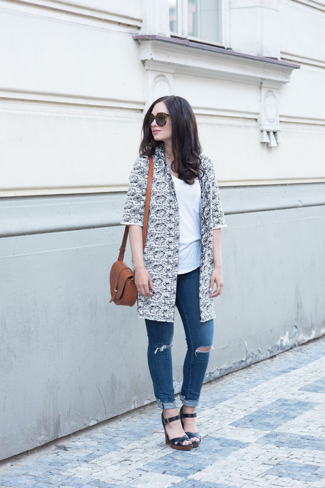 Fashion blogger Cee Fardoe of Coco & Vera wears a Floriane Fosso jacket and Paige jeans in Prague