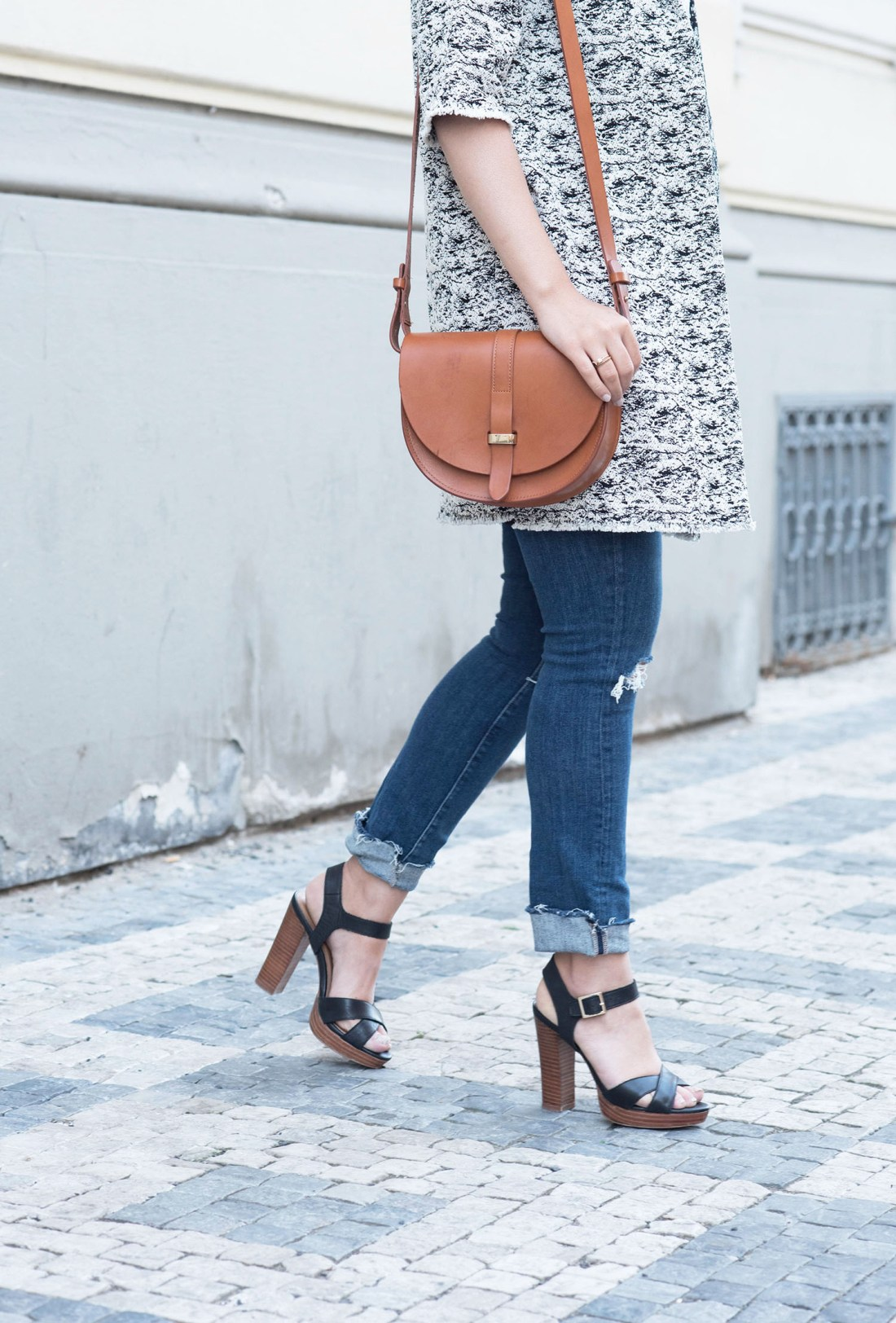 Outfit details on fashion blogger Cee Fardoe of Coco & Vera, including a Sezane Claude bag, Paige jeans and Le Chateau sandals