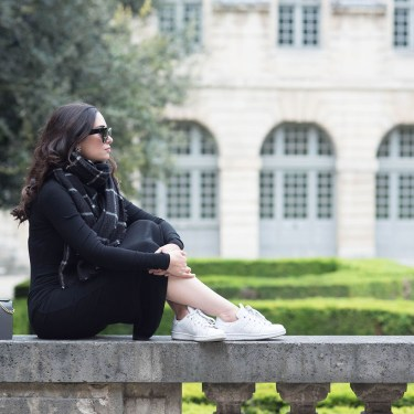 Winnipeg fashion blogger Cee Fardoe of Coco & Vera sits at the Hotel de Sully in Paris wearing a Privacy Please midway dress and Zara checked scarf