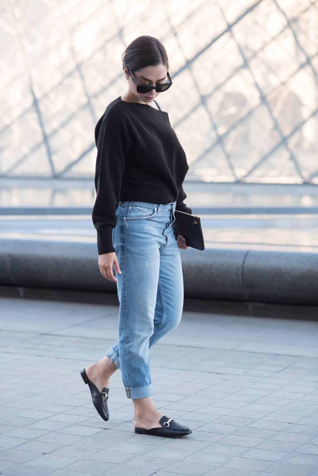 Fashion blogger Cee Fardoe of Coco & Vera stands outside the Louvre in Paris wearing Jonak mules and Zara boyfriend jeans