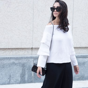 Portrait of brunette fashion blogger Cee Fardoe of Coco & Vera wearing Celine Audrey sunglasses and a white endless rose sweater