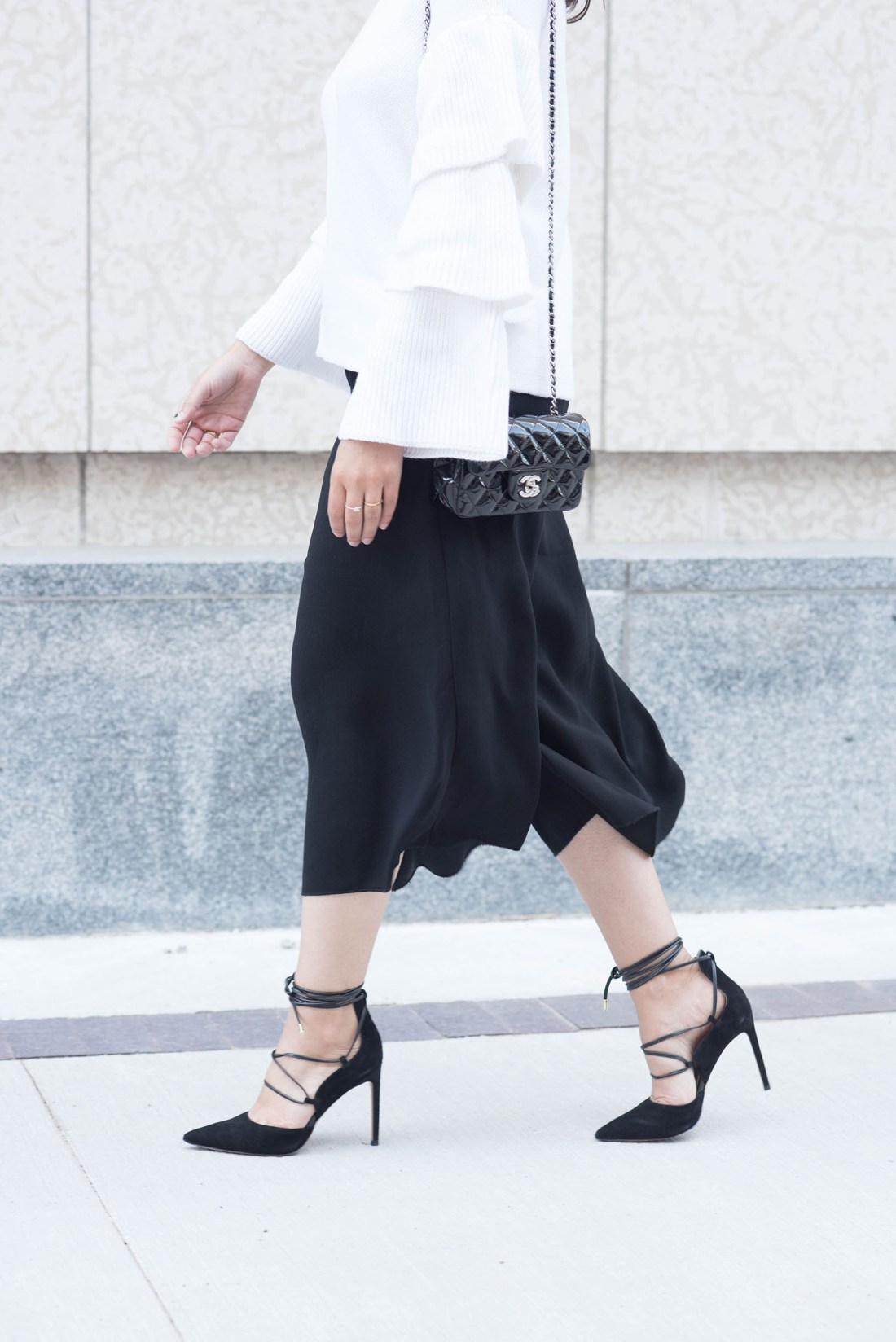 Outfit details on fashion blogger Cee Fardoe of Coco & Vera, including Aritzia culottes and Chanel Timeless handbag