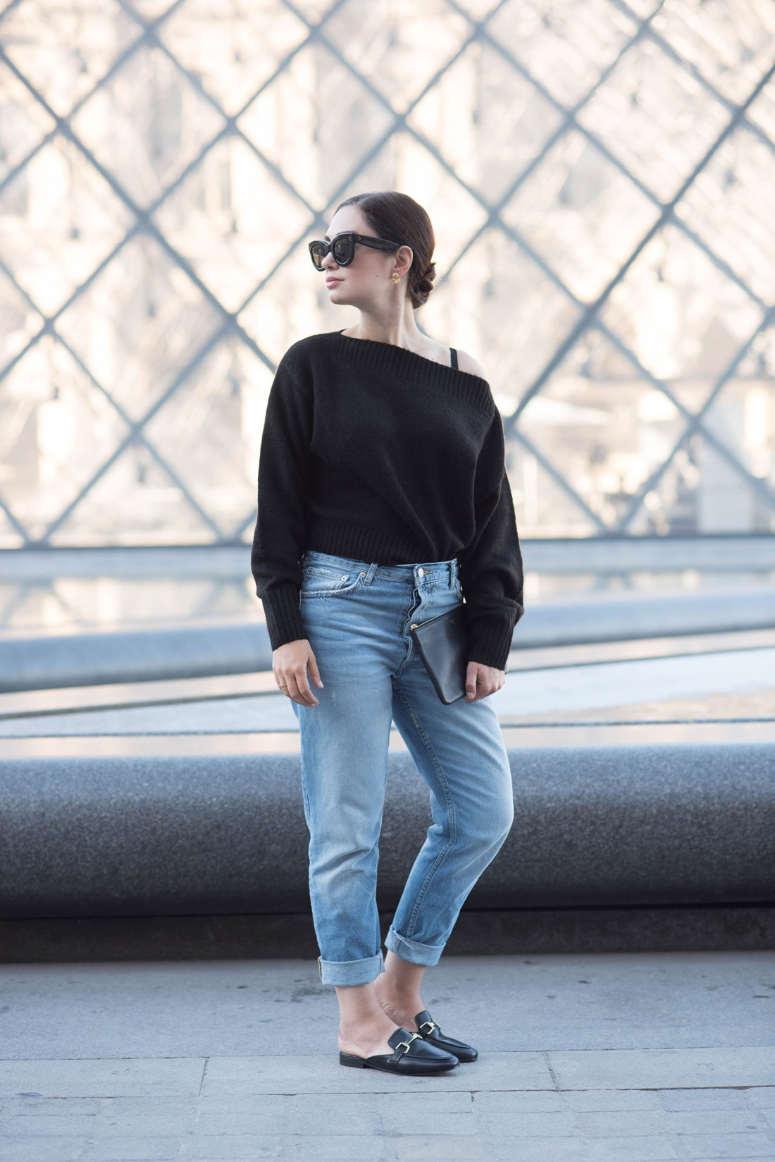Winnipeg fashion blogger Cee Fardoe of Coco & Vera outside the Louvre museum in Paris wearing a sweater from & Other Stories and Jonak mules