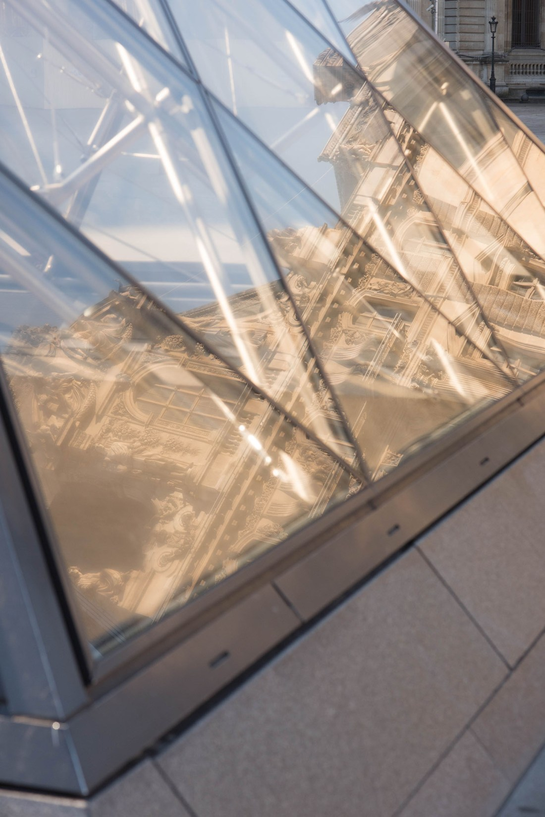 Reflections of the Palais du Louvre in the Louvre Pyramid in Paris, captured by top travel blogger Cee Fardoe of Coco & Vera