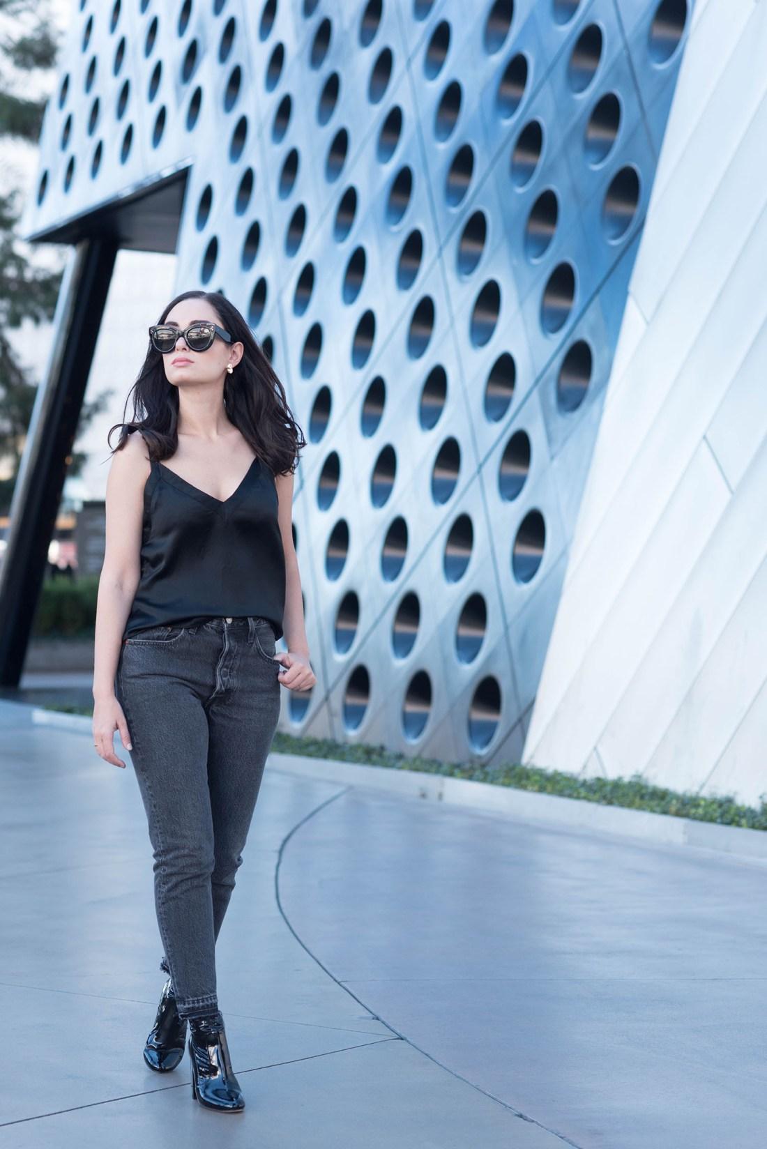 Fashion blogger Cee Fardoe of Coco & Vera walks in Las Vegas wears Levis 501 skinny jeans and Raye black patent boots
