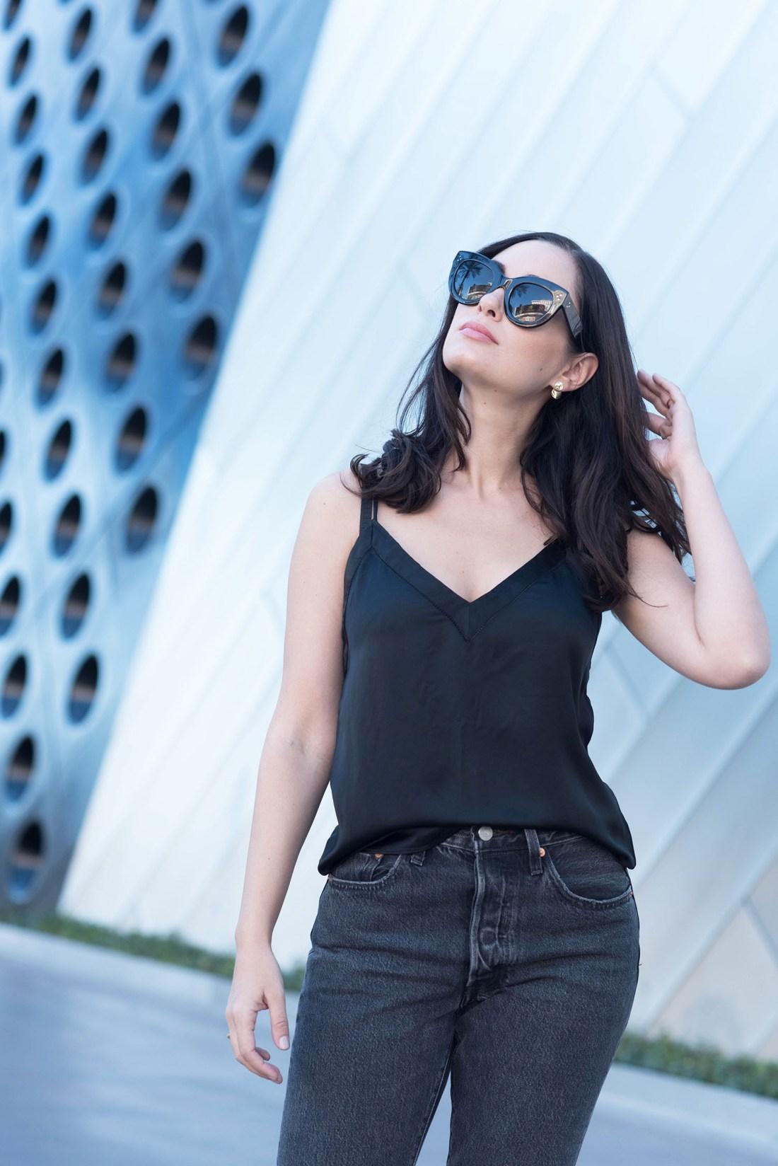 Portrait of fashion blogger Cee Fardoe of Coco & Vera in Las Vegas wearing Celine Audrey sunglasses and an Aritzia silk tank