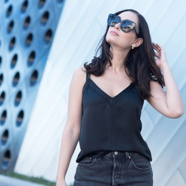 Portrait of fashion blogger Cee Fardoe of Coco & Vera in Las Vegas wearing Celine Audrey sunglasses and an Aritzia silk tank