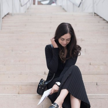 Fashion blogger Cee Fardoe of Coco & Vera at the Fondation Louis Vuitton in Paris wearing an Enza Costa wrap top and Rosefield silver watch