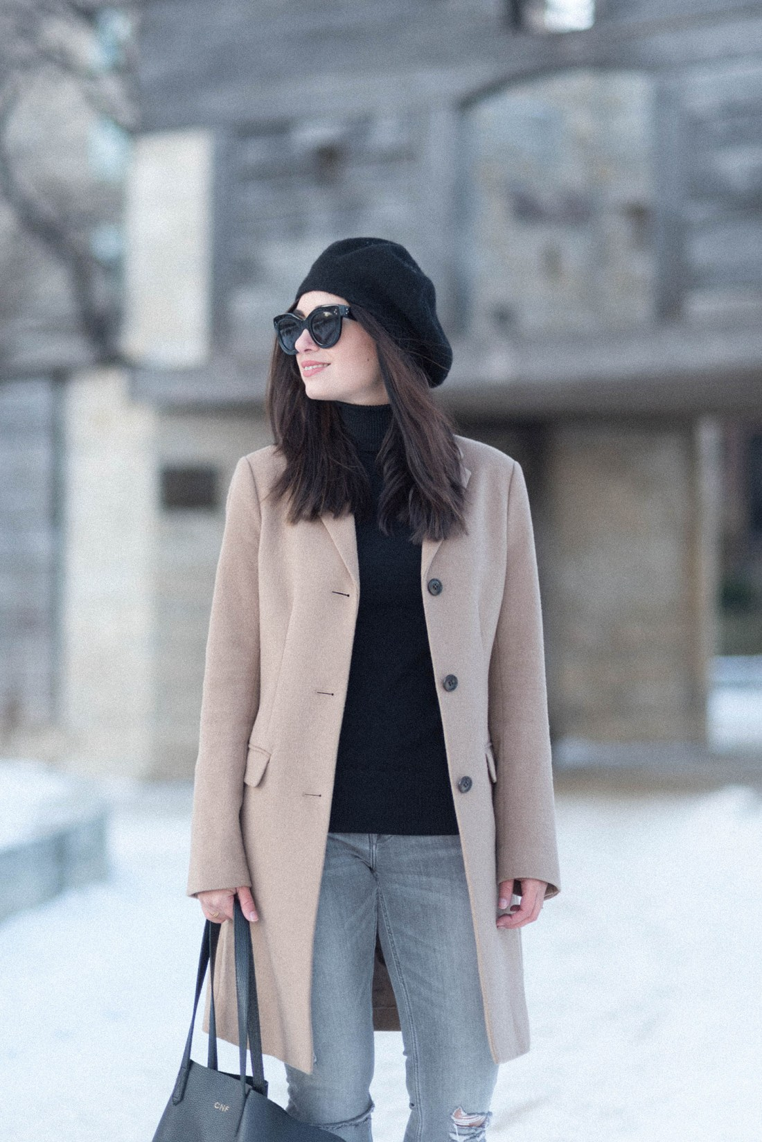 Portrait of Winnipeg fashion blogger Cee Fardoe at Fort Garry wearing Celine Audrey sunglasses and an Anthropologie Bonnie beret